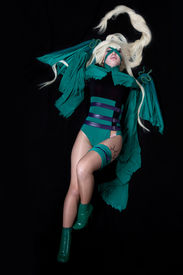 stock photo of banshee  - young blond girl posing in green fury cosplay costume anime character - JPG