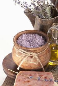 foto of lavender field  - Dry lavender, oils, salt, handwork soap on a wooden board ** Note: Shallow depth of field - JPG