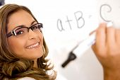 stock photo of student teacher  - casual education teacher or student writing on a white board - JPG