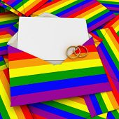 Envelope with the rainbow flag, a blank card and two wedding rings