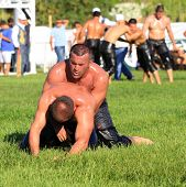 Wrestlers (Pehlivan) in a tight grip.