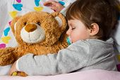 Sweet Child Sleeping With Teddy Bear