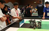 SUBANG JAYA - NOV 10: Unidentified students watch their robots with programmed response compete in a