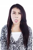 Playful Expression Tounge Out Of Woman Isolated In White
