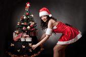 Santa girl open pull the Christmas tree.