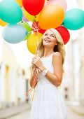 summer holidays, celebration and lifestyle concept - beautiful woman with colorful balloons in the c