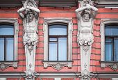 Facade With Men Statues Of An Old Palace In St.petersburg, Russia. Belosselsky-belozersky Palace Is