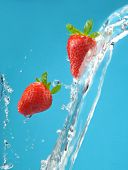 Fresh colored splash with strawberry
