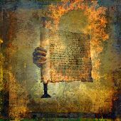 stock photo of intuition  - Hand holding a burning scroll - JPG