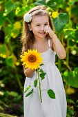 Young Smiling Girl With Sunflower