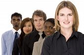 pic of ethnic group  - a diverse group of businessmen and women in a line - JPG