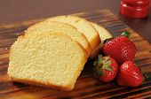 picture of pound cake  - Slices of rich moist pound cake with fresh strawberries - JPG