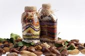 chestnuts, almonds, decorative bottles with different coloured seeds and hempen plug