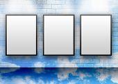 Three Blank White Displays On Cloud Wall