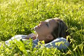 close-up of a girl lying on the green grass