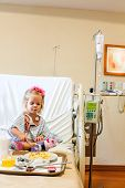 pic of intravenous  - Recovering Little baby girl hospitalized with a Intravenous bag on a pole - JPG