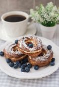 Cream Puffs Or Choux Pastry Rings With Blueberries On The Plate