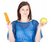 Young Woman Chose Between Apple And Carrot Over White Background