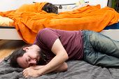 Dog And Man Change Roles Of Sleeping