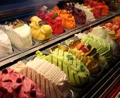 stock photo of gelato  - Colorful gelato flavors in display case - JPG