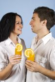 Happy Young Couple Wioth Fresh Orange Juice