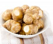 stock photo of jerusalem artichokes  - Jerusalem Artichoke in a white bowl  - JPG
