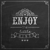 Enjoy The Little Things Quote Typographical Background On Blackboard With Chalk