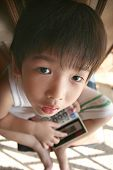 Boy Holding Calculator Looking Up poster