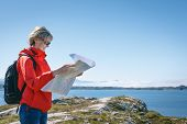 foto of fjord  - Woman tourist reading the map - JPG