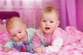 stock photo of baby-boy  - portrait of two babies in pink room - JPG