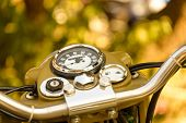 Vintage khaki motorcycle dashboard close-up