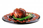 roast red beef meat bbq bloc served on black plate  with green chives and red hot pepper on black pl
