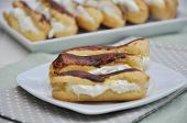 picture of eclairs  - home made chocolate eclairs on a white plate - JPG