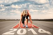 stock photo of sprinters  - Female sprinter waiting for the start on an airport runway - JPG