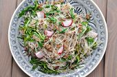 Salad with fine Chinese noddles and chicken