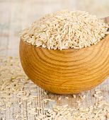 Brown Rice On A Wooden Table