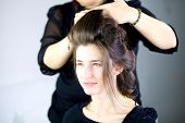Beautiful Female Model Getting Hair Done By Professional Hairstylist