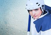 Beautiful Ice Hockey Female Player Fashion Portrait On The Ice Background