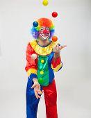 Funny clown juggling balls