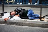 Homeless Man Sleeping On The Street In Paris