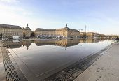 BORDEAUX, FRANCE - DECEMBER 22, 2011:  The Quay Mirror in front of the Place Royale (Place de la Bourse).  This water mirror covers a 3450 m2, which makes it the largest water mirror in the world.