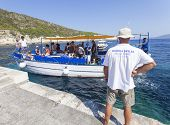 VIS, CROATIA - AUGUST 20, 2012: Tourist boat heading for the Blue cave, famous tourist attraction.