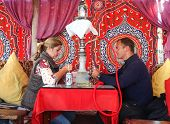 DAHAB, EGYPT - JANUARY 24, 2011: Couple sitting in the oriental bar with nargile at table. These wat