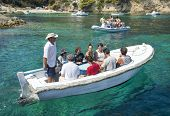VIS, CROATIA - AUGUST 20, 2012: Tourists on boat to the Blue Hole cave which is the main attraction