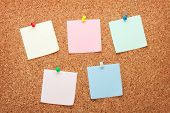 Blank postit notes on cork wood notice board