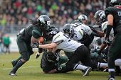 VIENNA,  AUSTRIA - APRIL 6 LB Dan Krejbich  (#50 Panthers) and RB Tunde Ogun (#1 Dragons) fight for