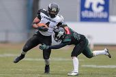 VIENNA,  AUSTRIA - APRIL 6 DB Mario Vetr (#23 Dragons) tackles DB Andre Whyte (#4 Panthers) during t