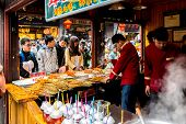 CHONGQING, CHINA - JAN 17: Unidentified merchants are selling traditional food on January  17, 2014