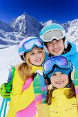 Ski, winter, snow, skiers, sun and fun - young skiers enjoying winter holidays