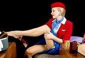 picture of stripper shoes  - Retro airline hostess removing her stockings and shoes - JPG